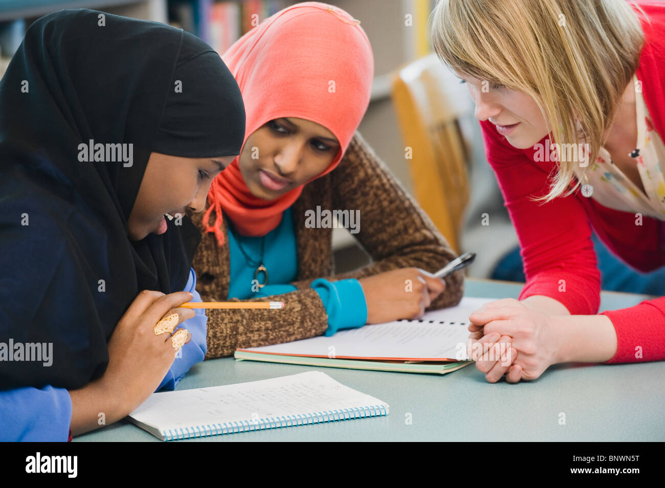 Adults students learning English as a second language - Stock Image