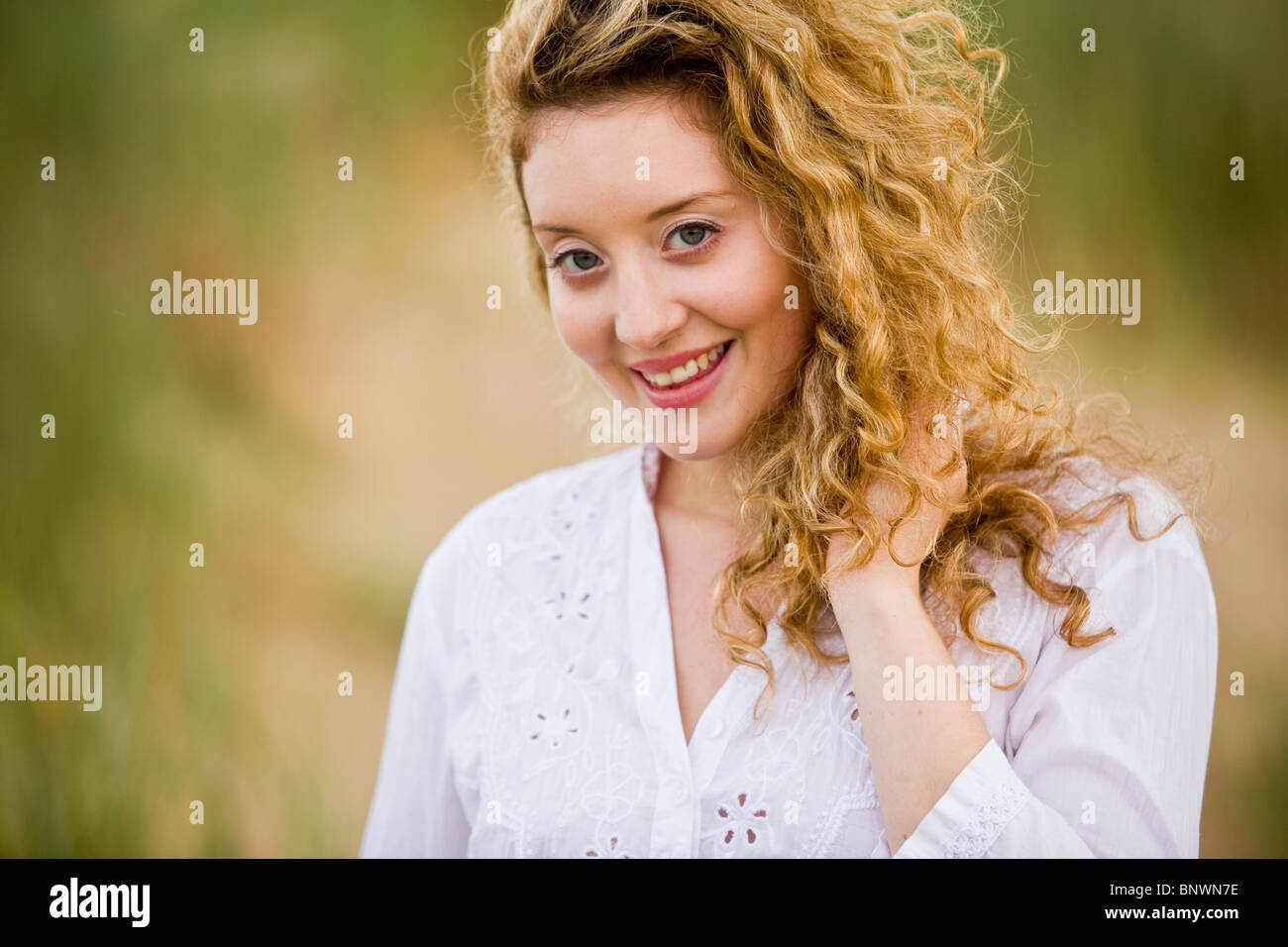 Portrait of attractive woman outdoors - Stock Image