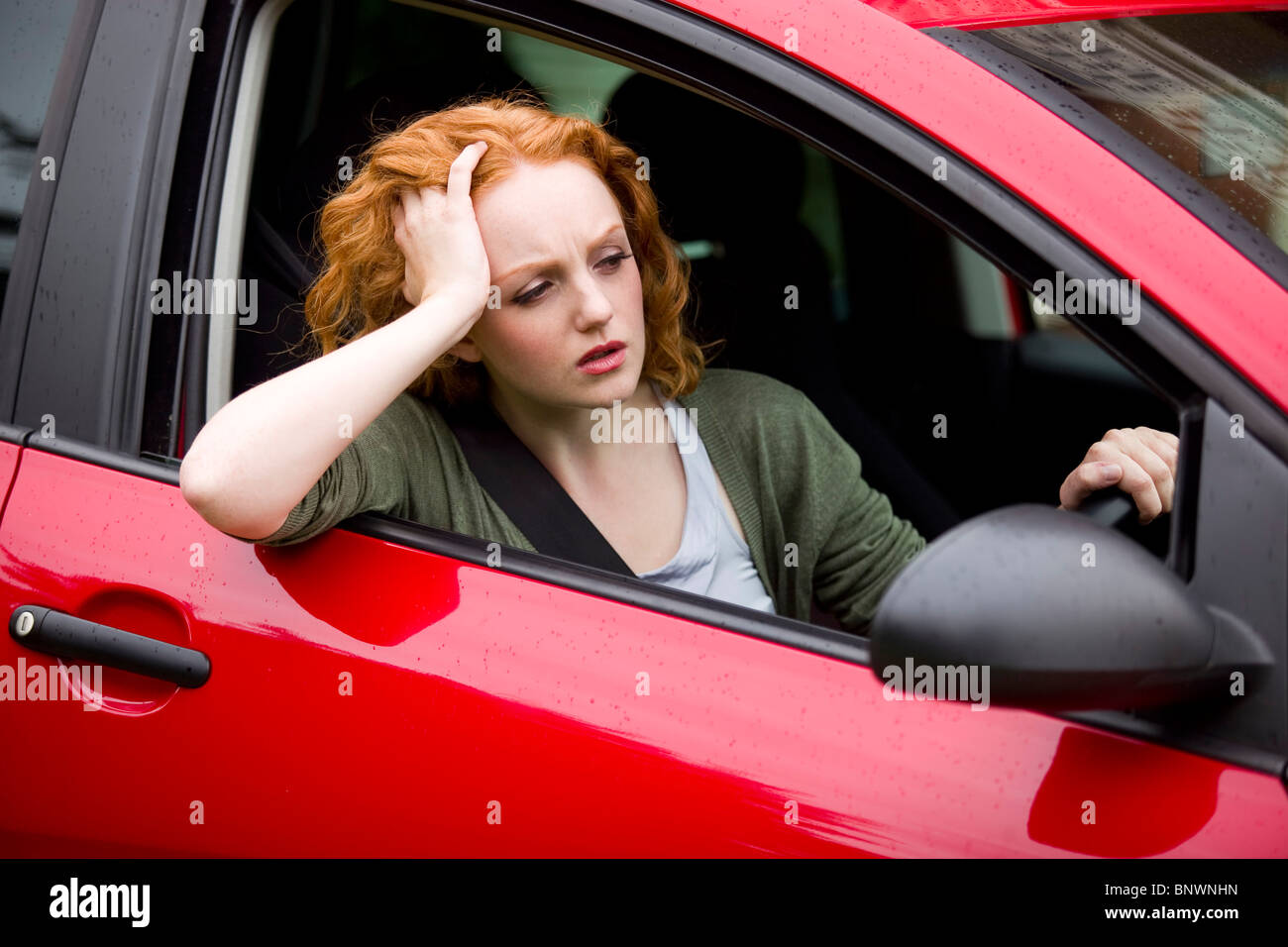 Girl sat in car - Stock Image