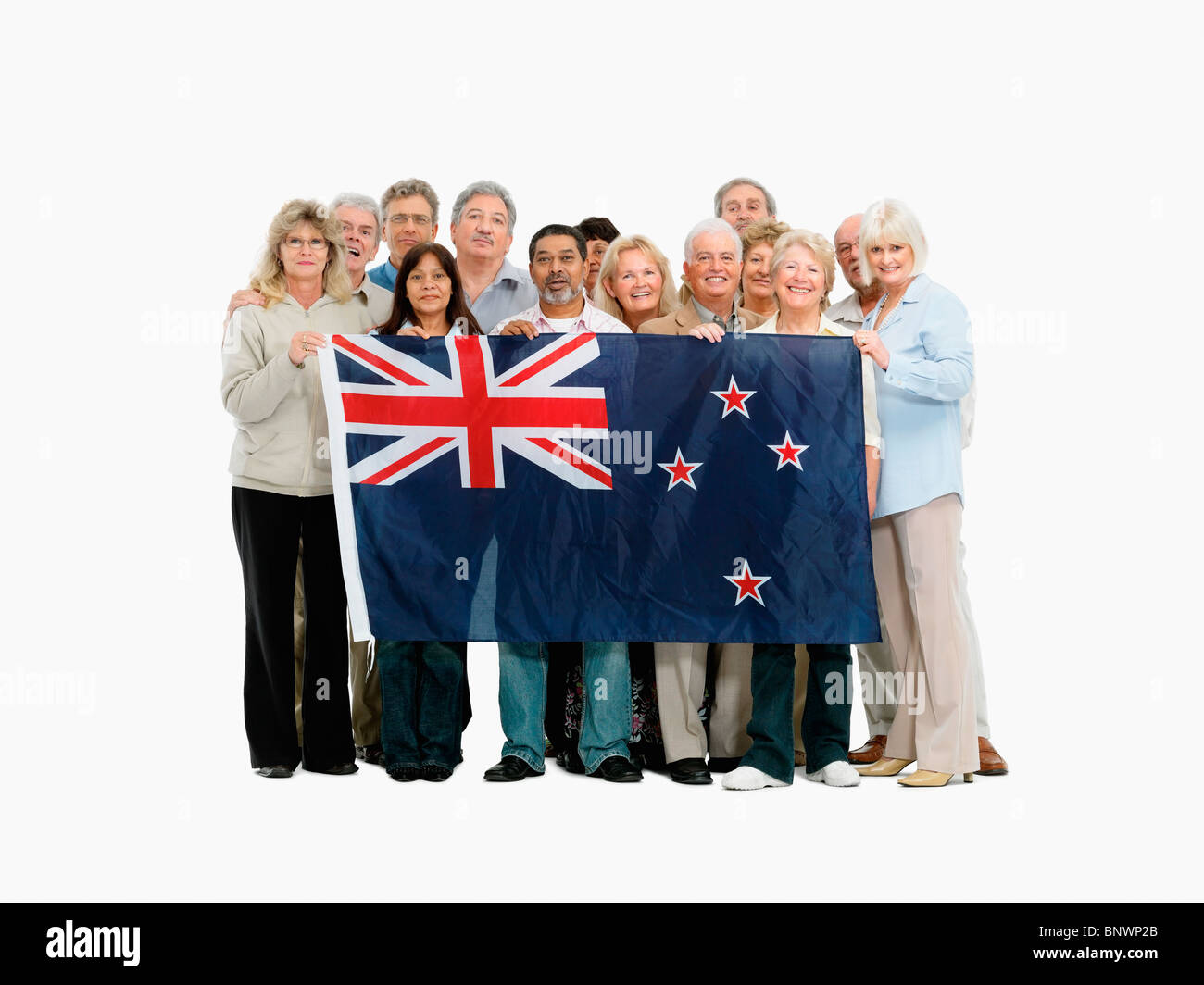 group of people holding the New Zealand flag - Stock Image