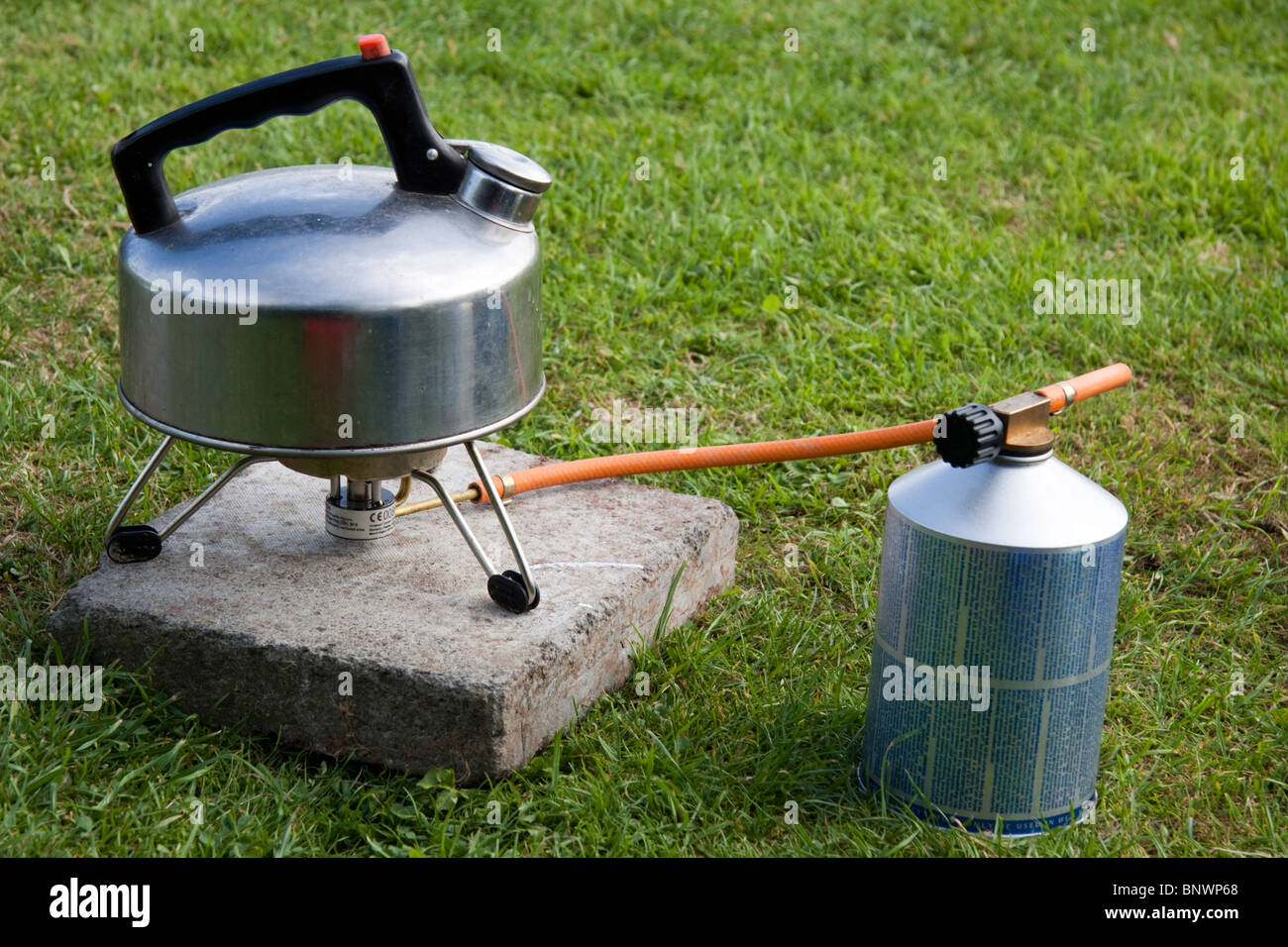 Camping gas cooker with kettle - Stock Image