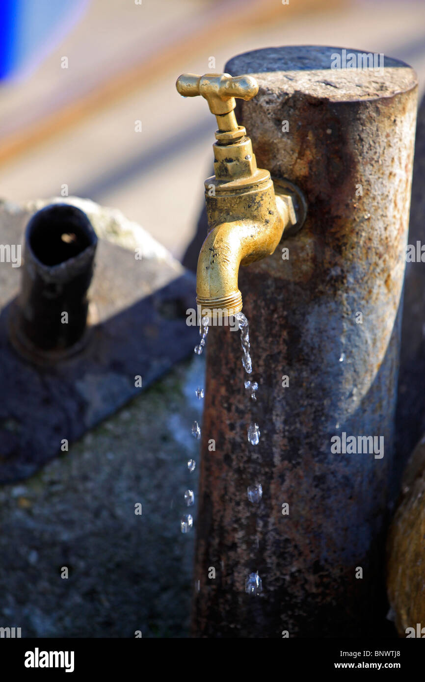 Dripping tap at Hout Bay harbour . - Stock Image