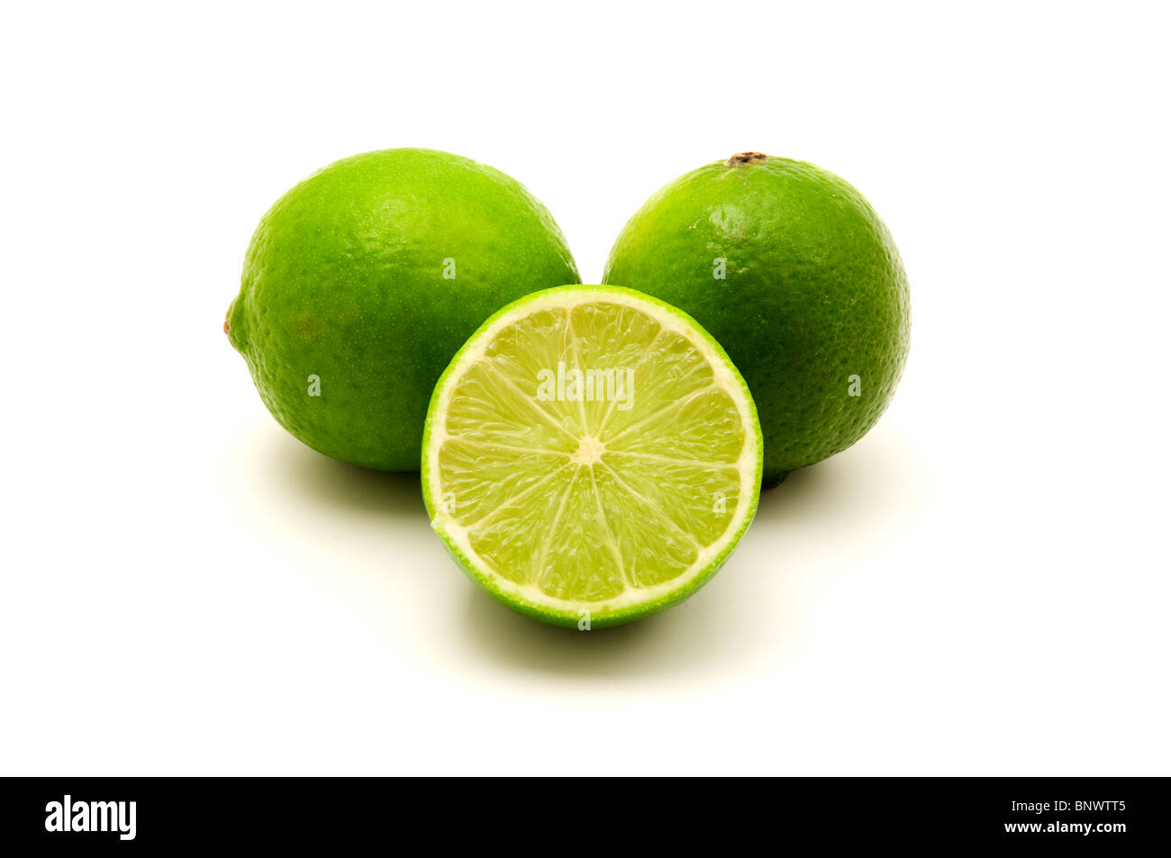 Persian limes on a white background - Stock Image