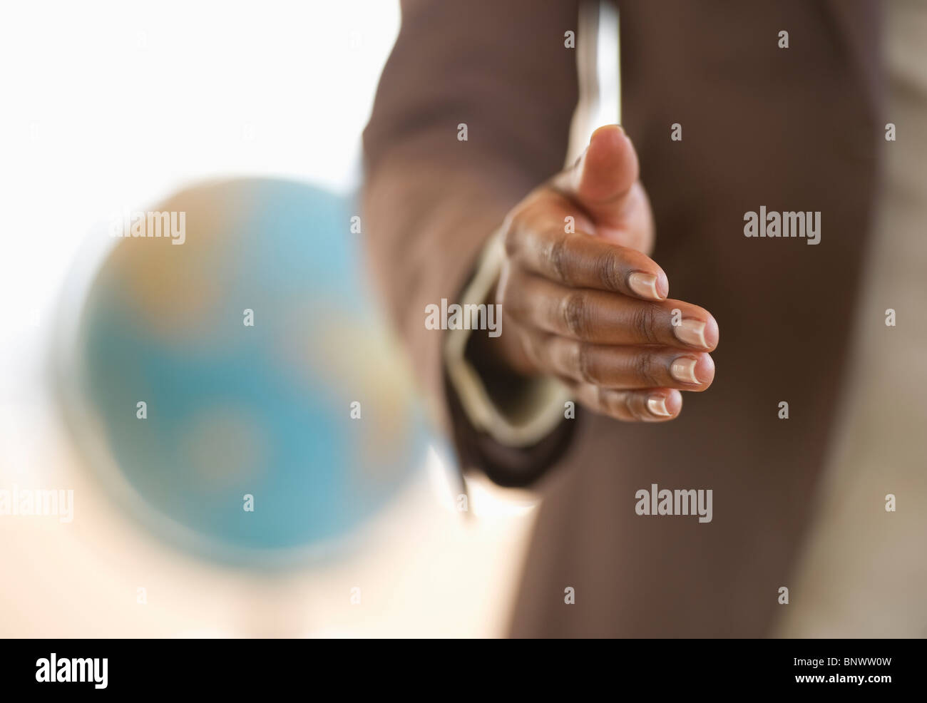 Hand extended for handshake - Stock Image