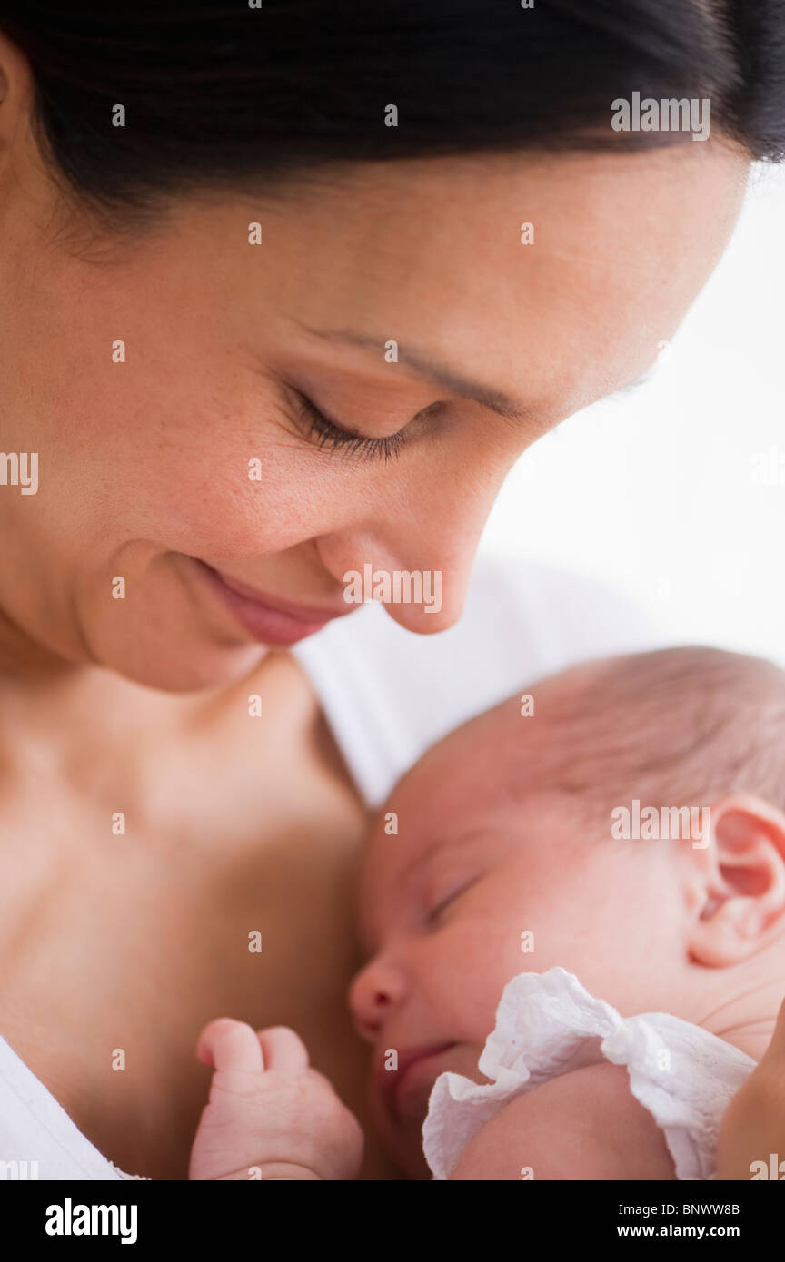 Mother holding her sleeping baby Stock Photo