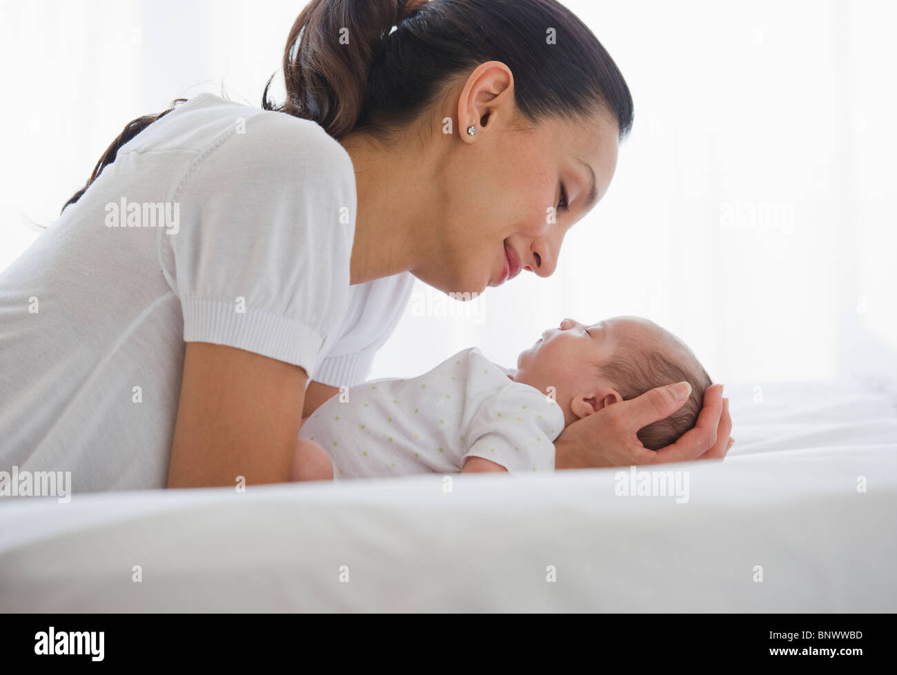 Mother sharing a tender moment with her baby Stock Photo