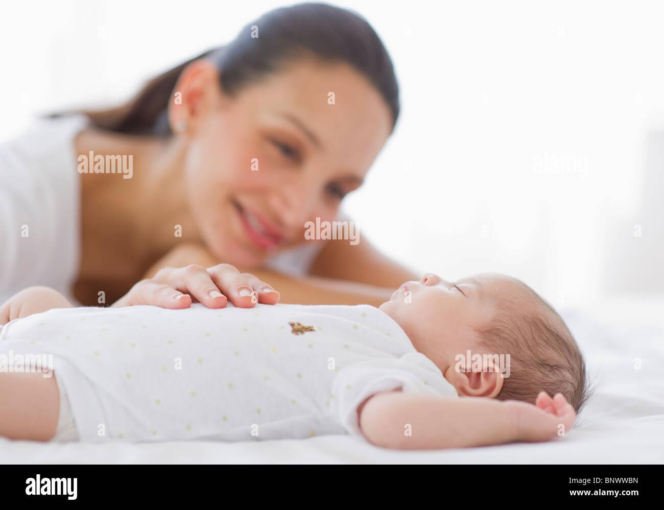 Mother watching her baby sleep Stock Photo