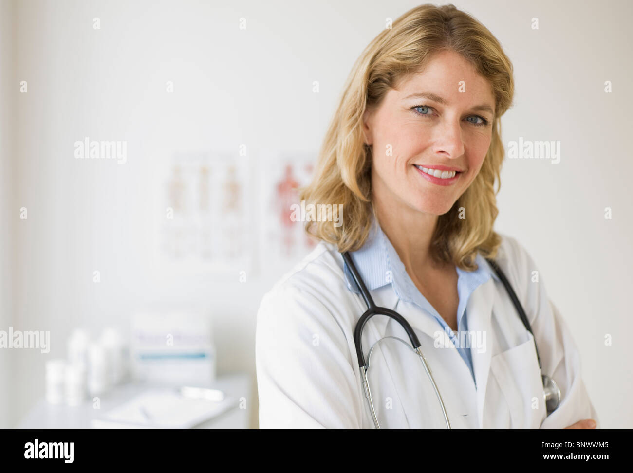 Female doctor in her office - Stock Image
