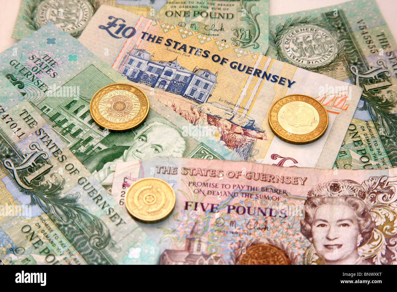 Guernsey pound notes. The Channel island has its own money, convertible to the British pound, but only accepted - Stock Image