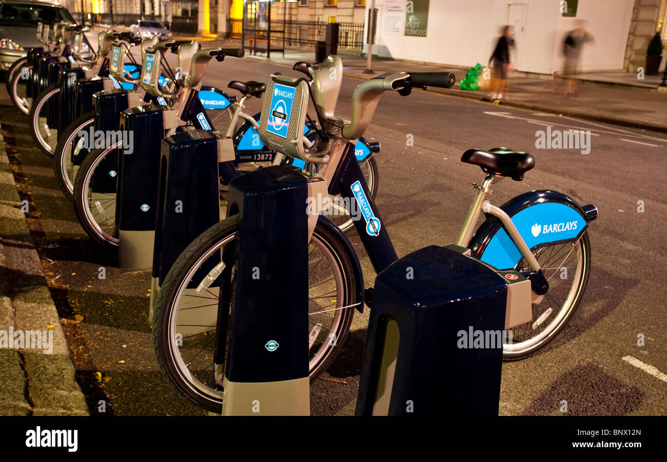 Futuristic docking station as part of the new London's Barclays bicycle hire scheme, London, England, UK. - Stock Image
