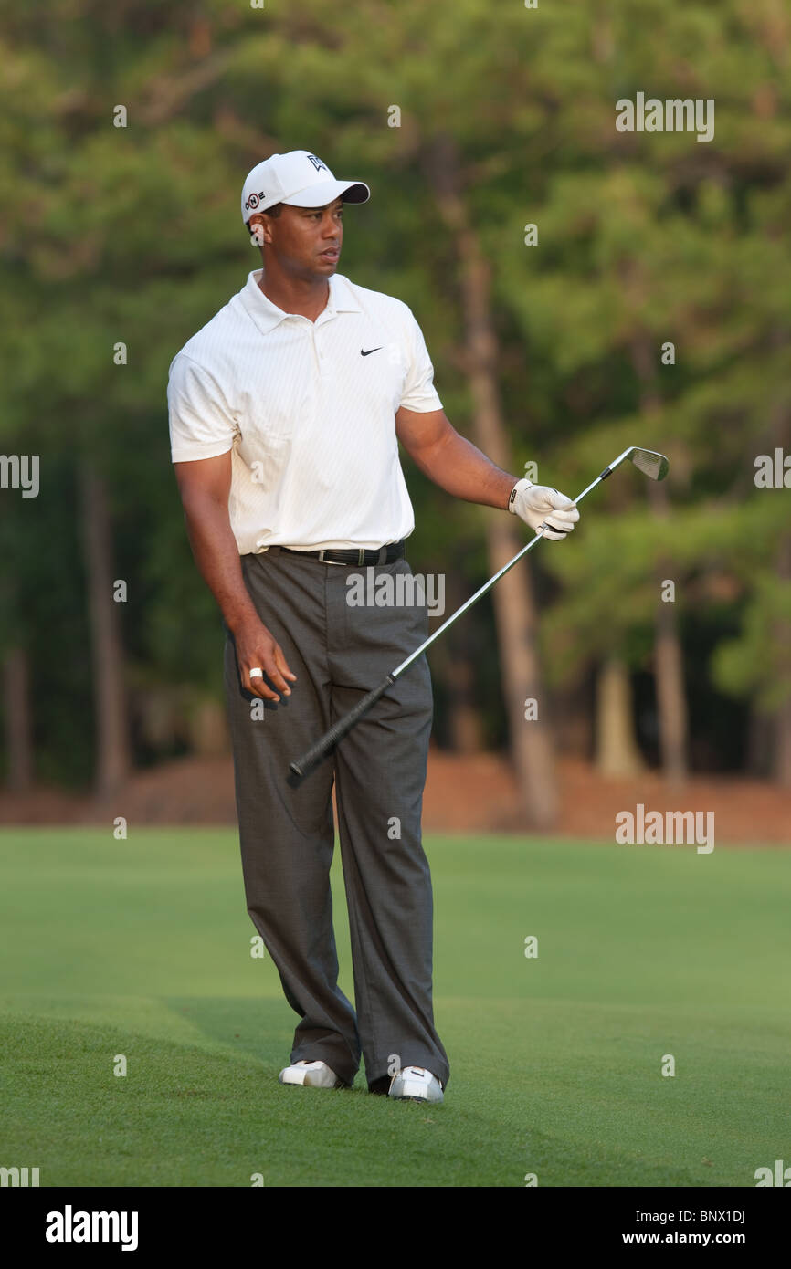 Tiger Woods hits his approach shot on the par 4 10th hole during a practice round of the 2009 Players Championship. - Stock Image