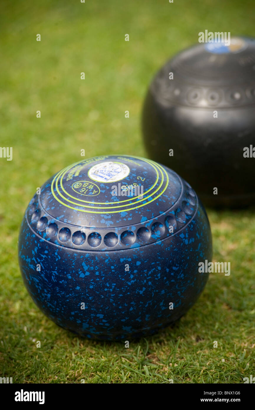 Two bowls in a game of outdoor lawn bowls - Stock Image