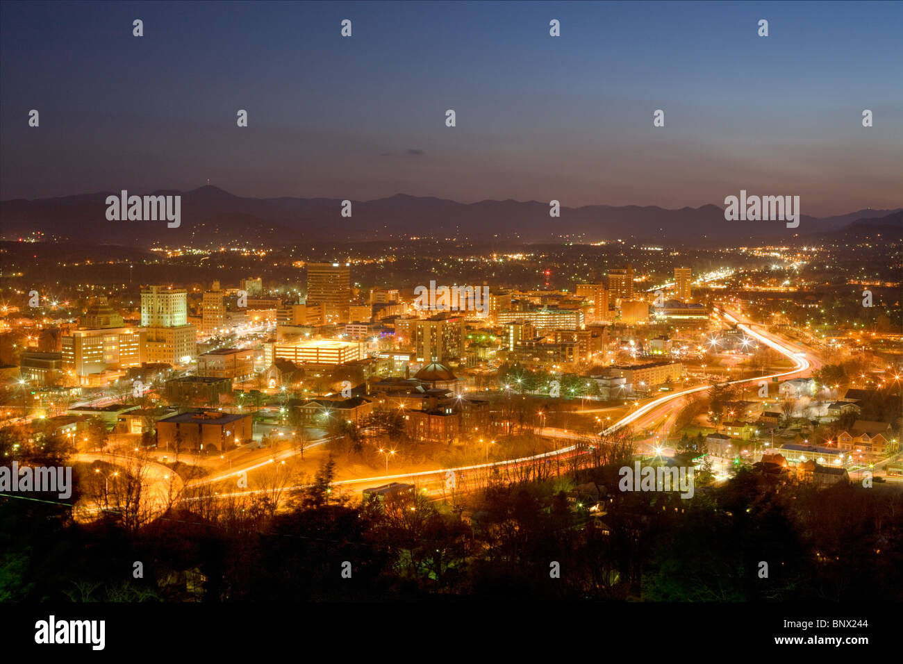 City skyline of Asheville, North Carolina, nestled in Blue Ridge Mountains - Stock Image