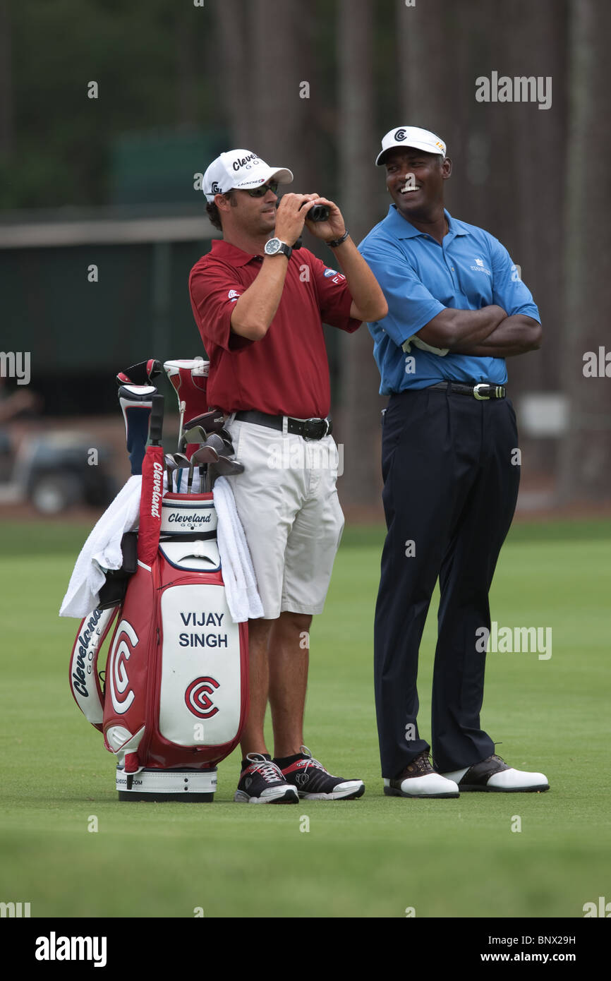Vijay Singh and caddie Chad Reynolds wait on the 16th fairway during a practice round of the 2009 Players Championship. - Stock Image