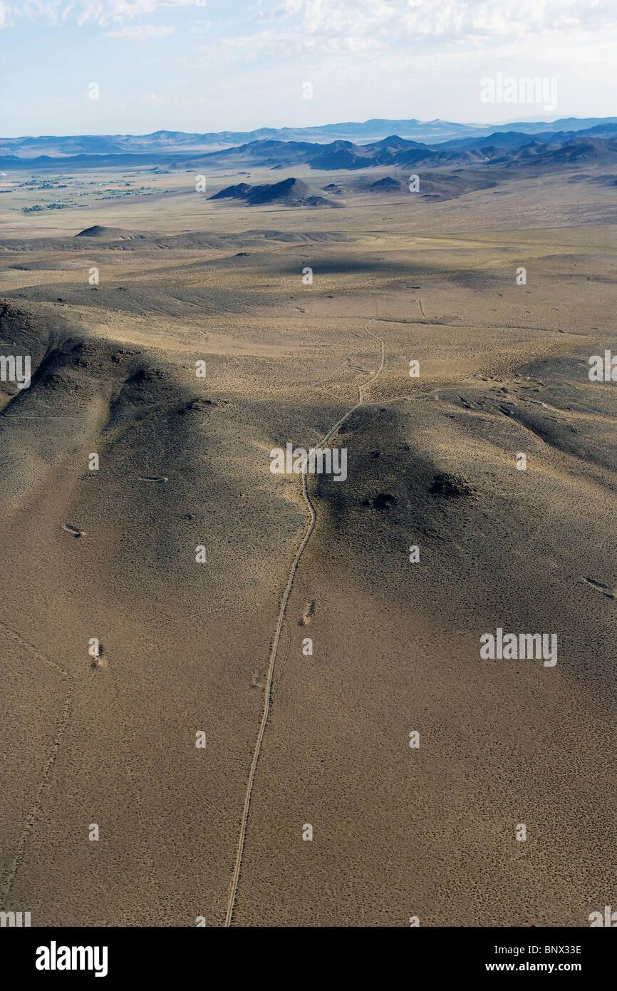 aerial photograph desolate road through desert Nevada - Stock Image