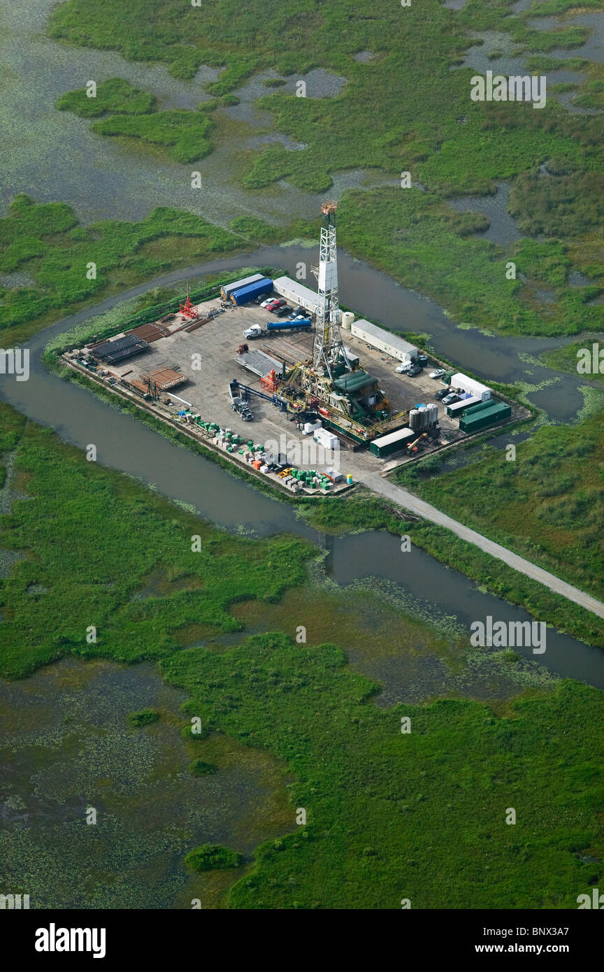 aerial view above oil and gas extraction upper Gulf coast coastal wetlands Texas - Stock Image