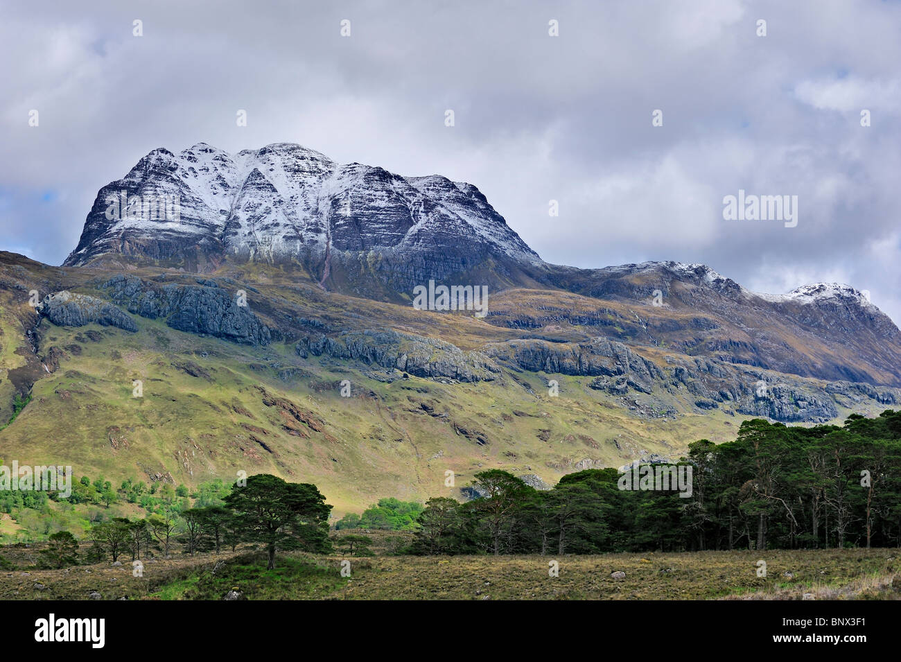 The mountain Slioch covered in snow in spring, Wester Ross, Highlands, Scotland, UK Stock Photo