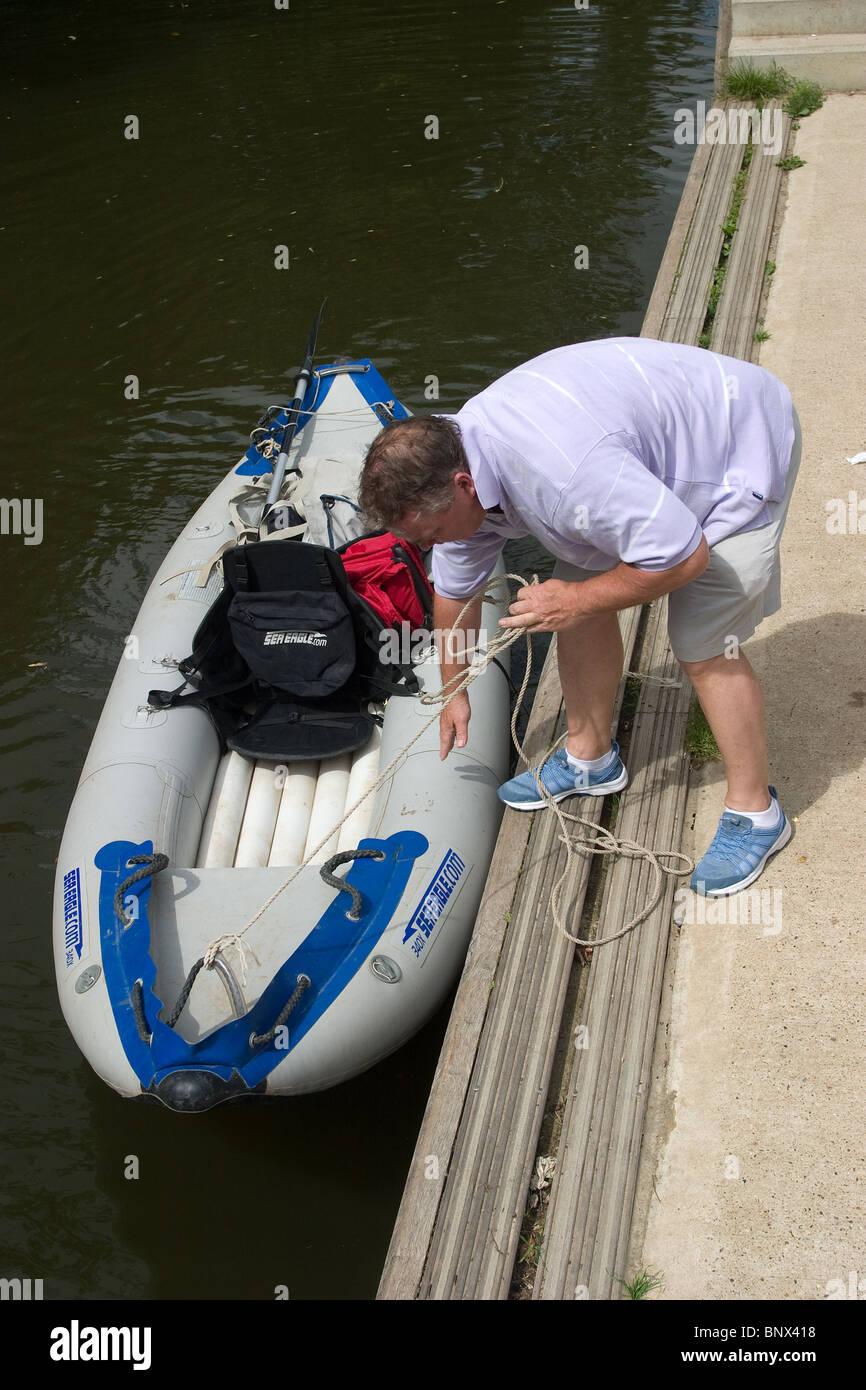 canoe canoeist inflatable portage river launching - Stock Image