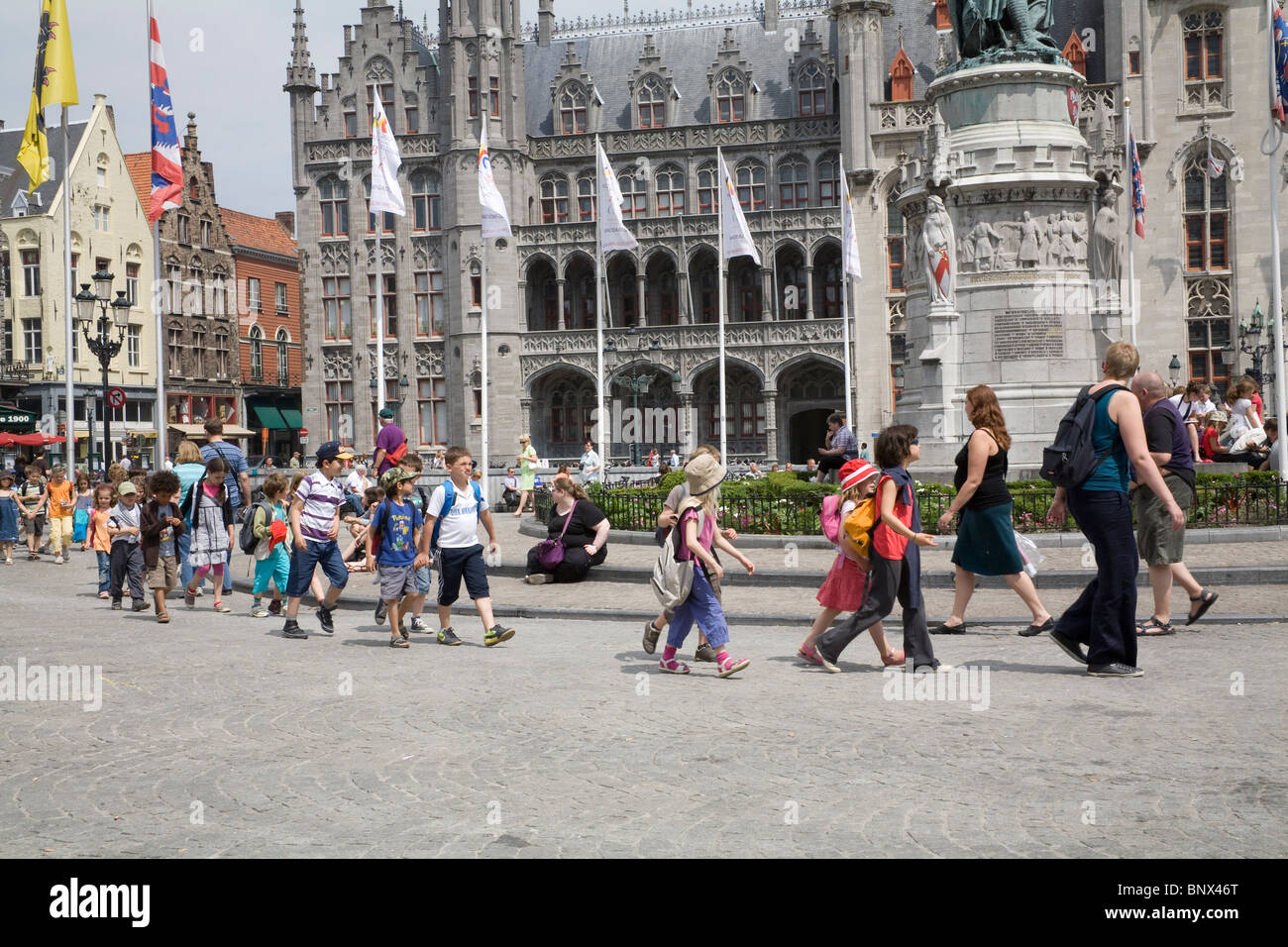 Bruges Belgium Europe EU Group of schoolchildren crossing Markt on a school trip to this lovely city - Stock Image