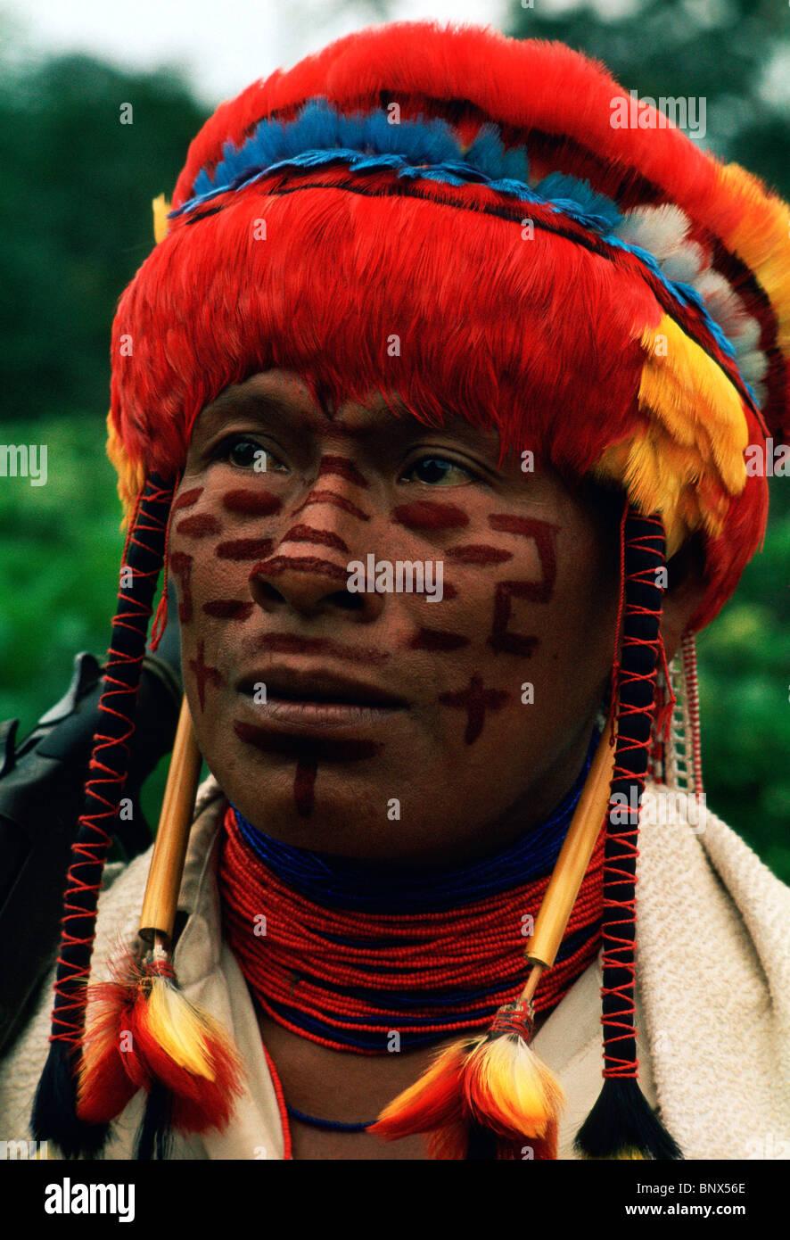 Portrait of Achual tribe headman wearing feather headdress; southern Ecuador / northern Peru. - Stock Image