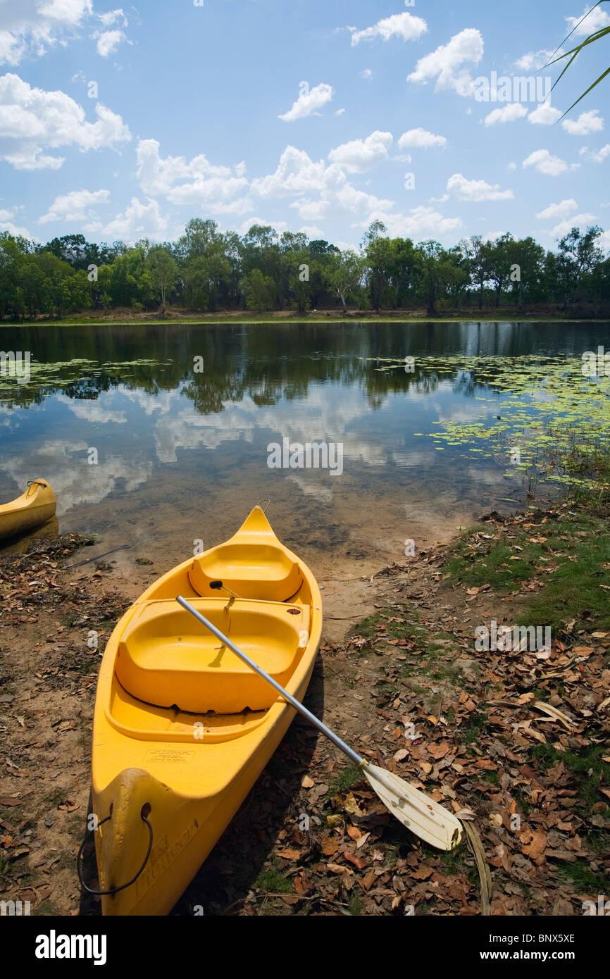Canoe on the banks of Annaburroo Billabong, near Kakadu National Park, Northern Territory, Australia. - Stock Image