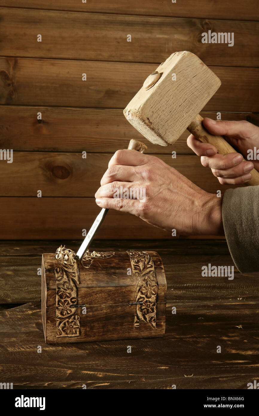 gouge wood chisel carpenter tool hand hammer craftman - Stock Image