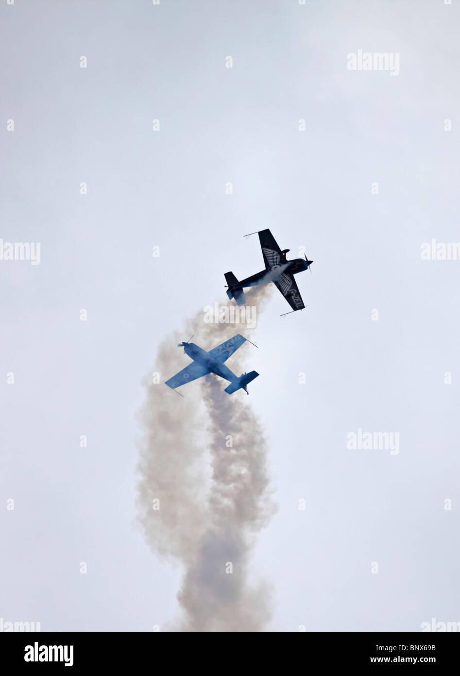 Farnborough The Blades Extra 300 LPS aerobatic display aircraft - Stock Image