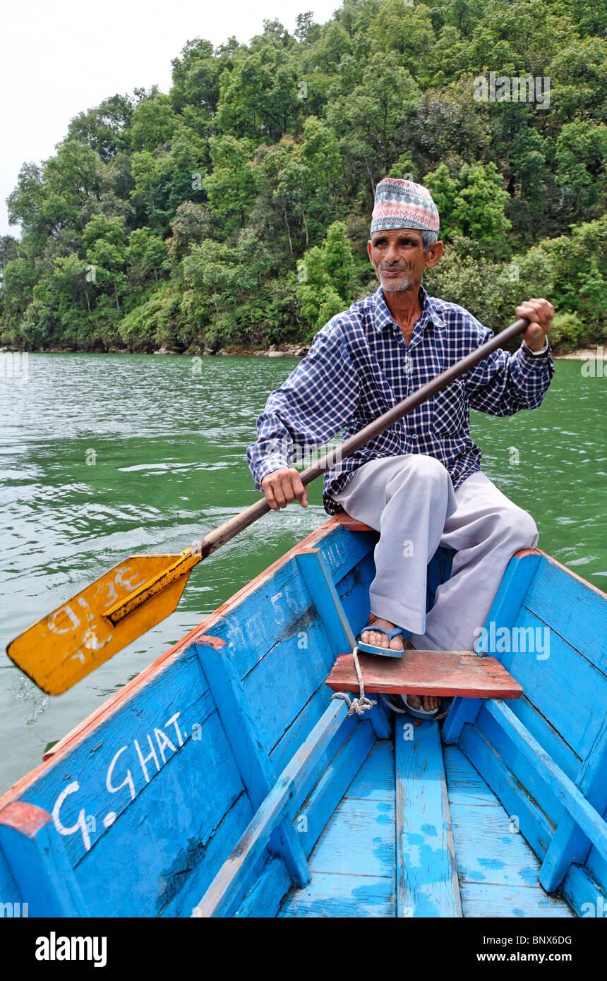 Nepal - Pokhara - Lake Phewa - man rowing a boat - Stock Image