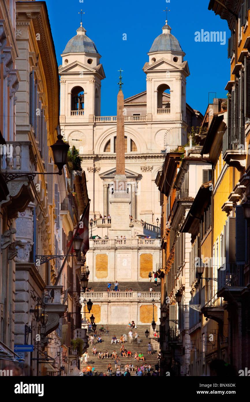 View down Via Condotti with Spanish Steps and Trinità dei Monti beyond, Rome Lazio Italy - Stock Image