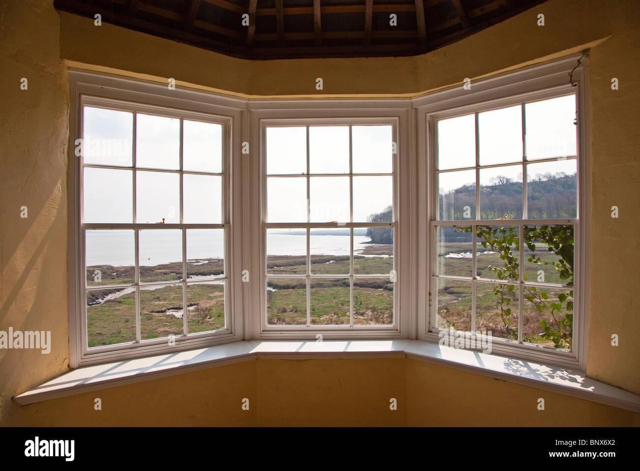 View from summerhouse in castle ruins where Dylan Thomas and Richard Hughes and wrote Laugharne Wales UK - Stock Image