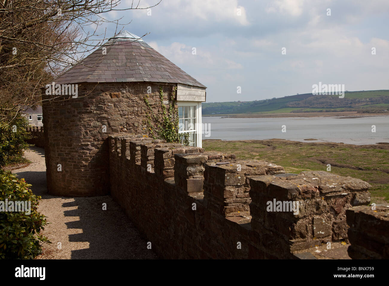 Laugharne castle battlement with summerhouse build into crenellations where Dylan Thomas used to write Wales UK - Stock Image
