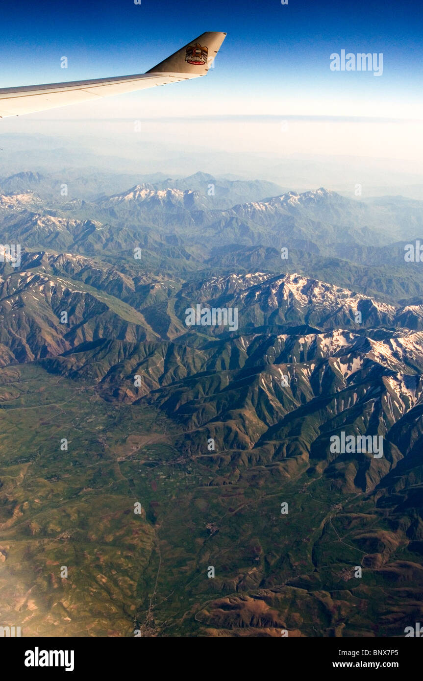Airbus aircraft operated by Etihad Airways emerging from the Anatolian mountains over southeastern Turkey in early - Stock Image