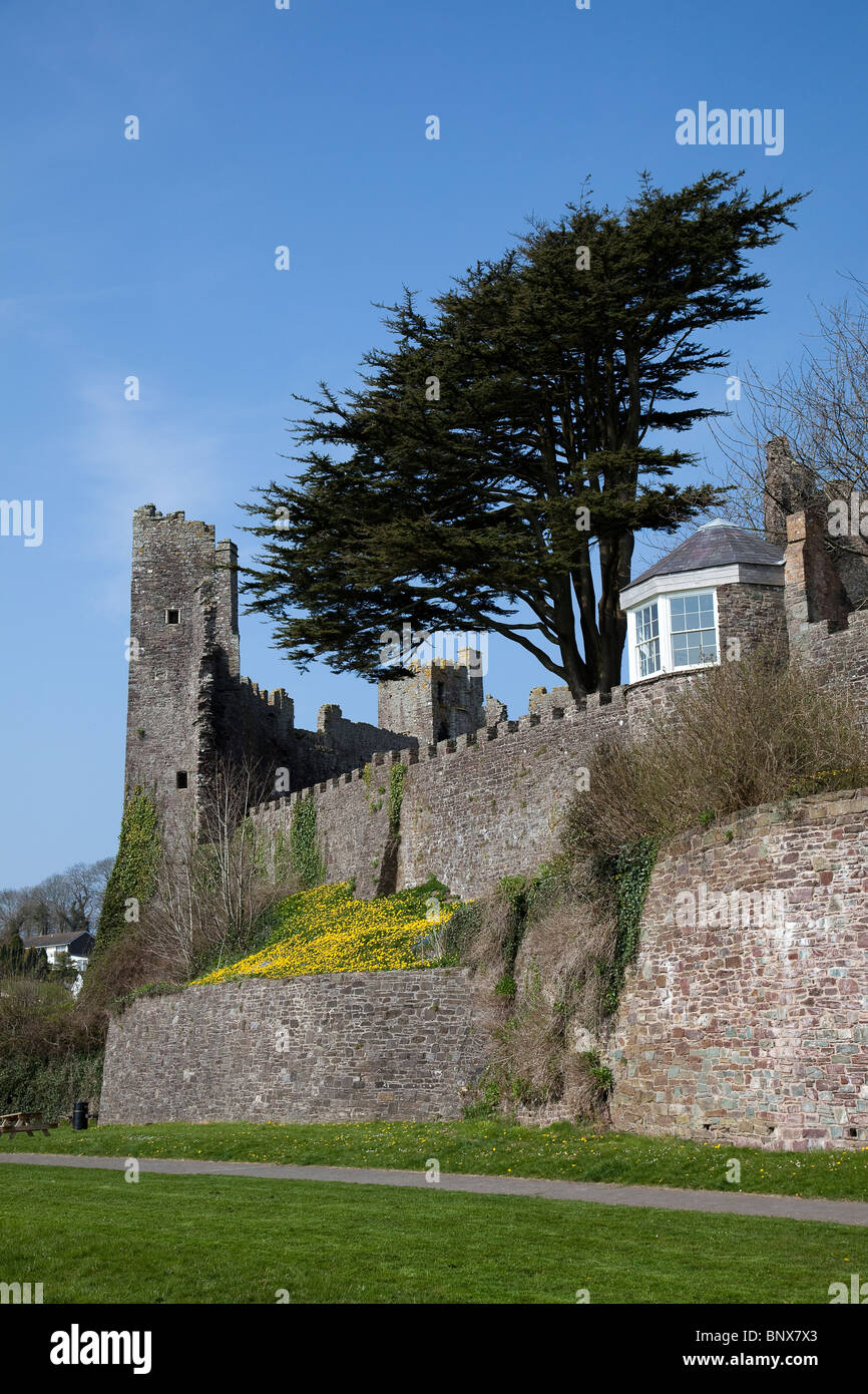 Ruined castle and summerhouse where Dylan Thomas wrote Laugharne Wales UK - Stock Image