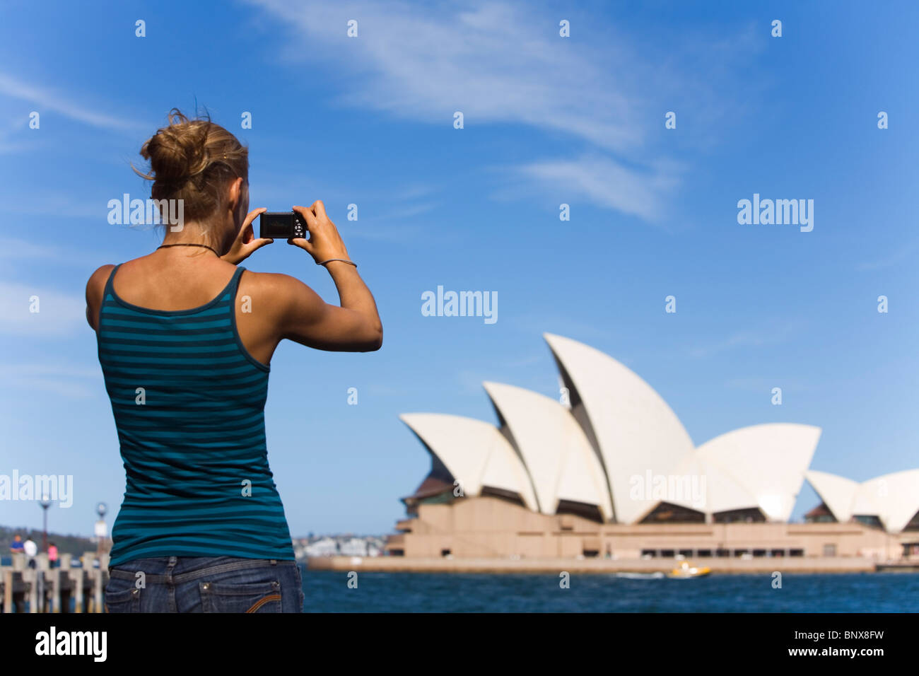 A woman photographs the Opera House in Sydney, New South Wales, AUSTRALIA. Stock Photo