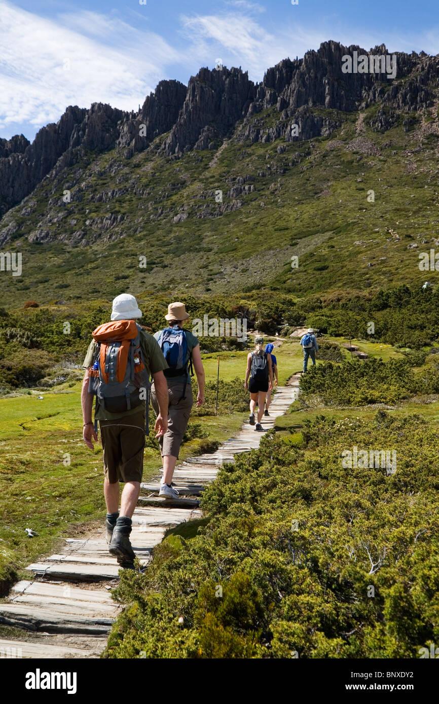 Hikers on the summit trail. Cradle Mountain-Lake St Clair National Park, Tasmania, AUSTRALIA - Stock Image