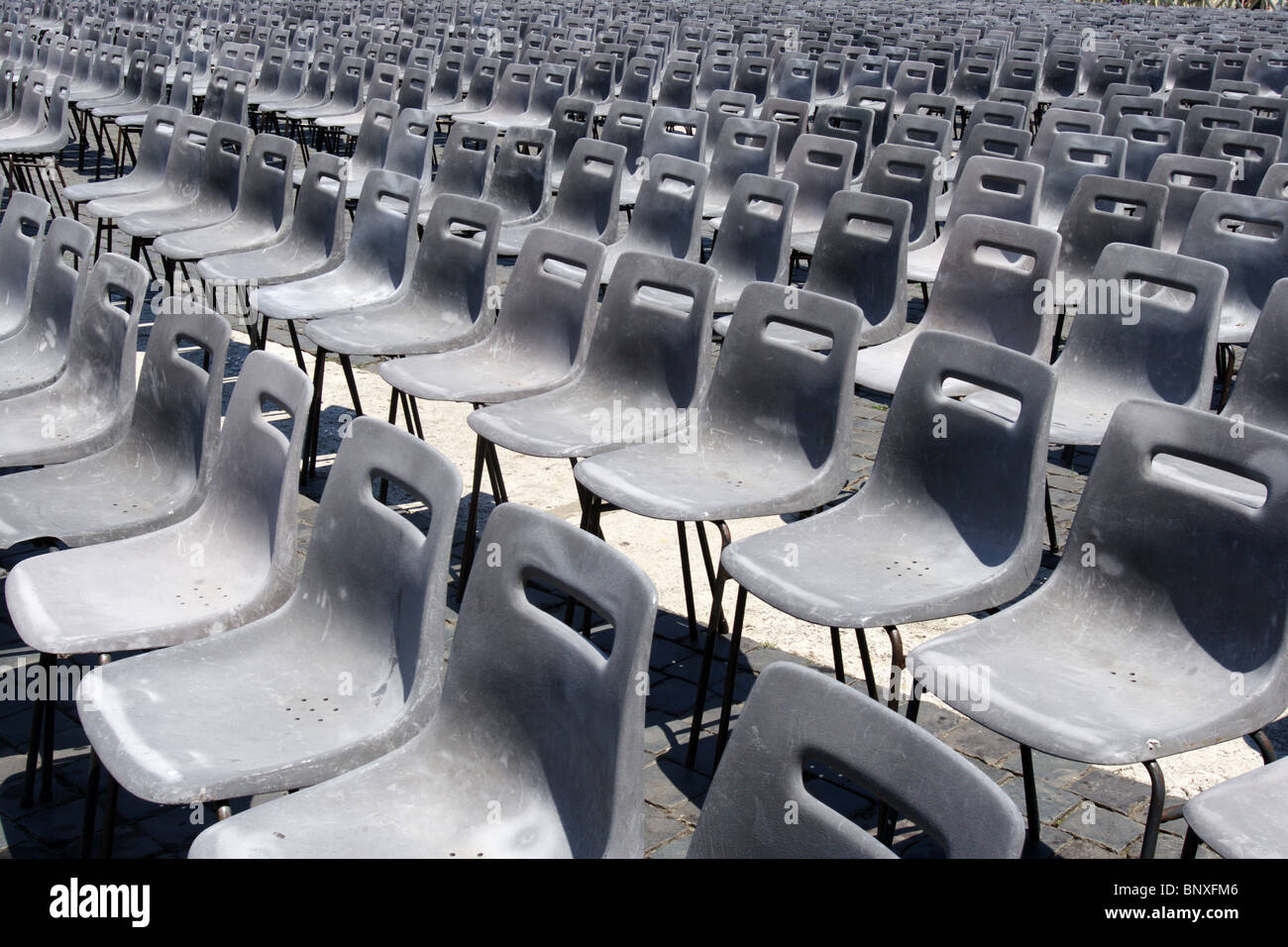 plastic chairs ordered St.Peter Rome Vatican group - Stock Image