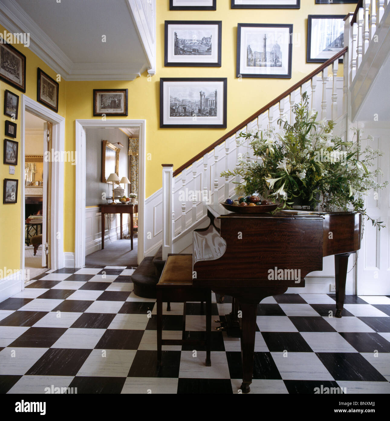 Large Flower Arrangement On Grand Piano In Yellow Country