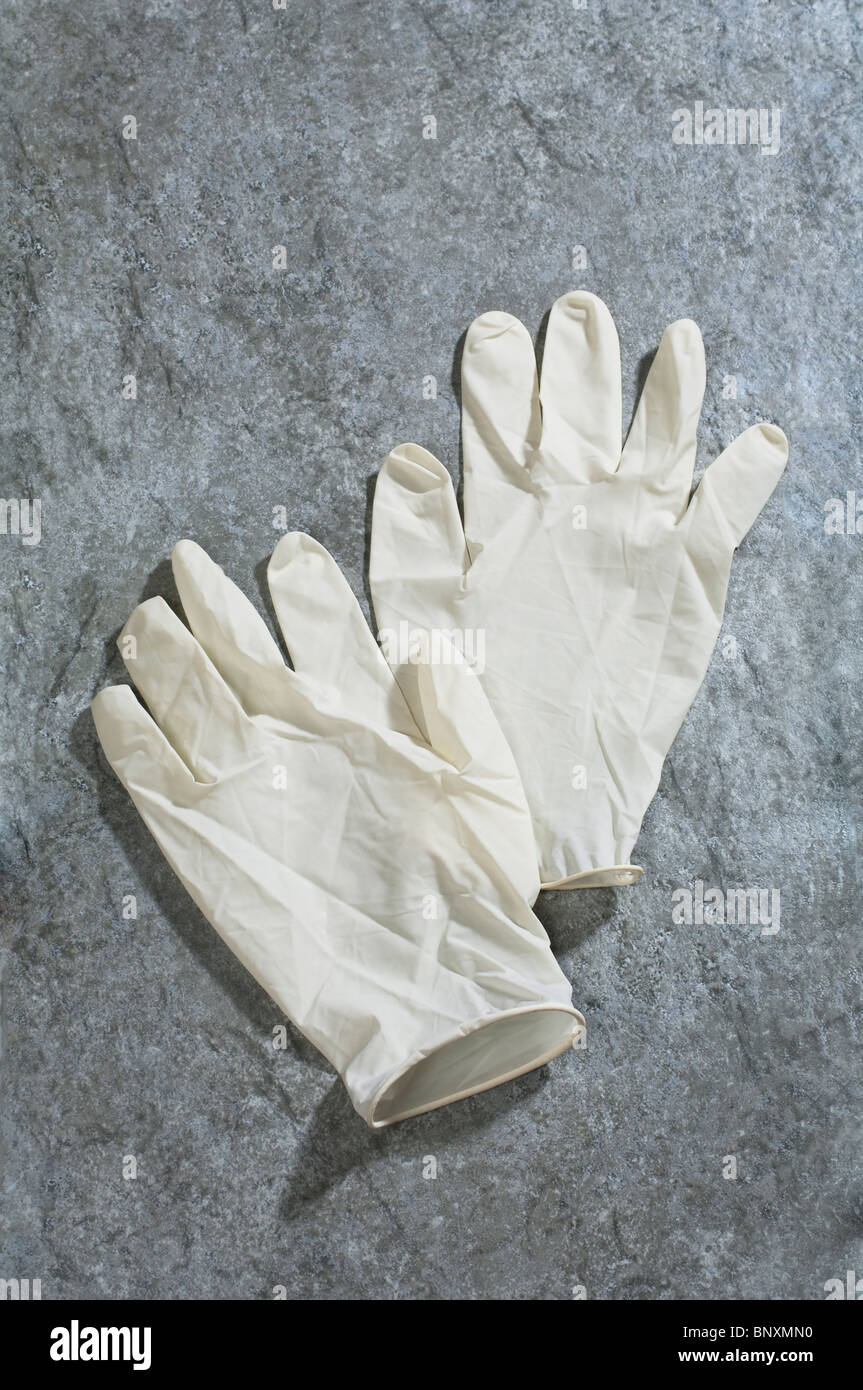 A pair of medical latex rubber gloves - Stock Image