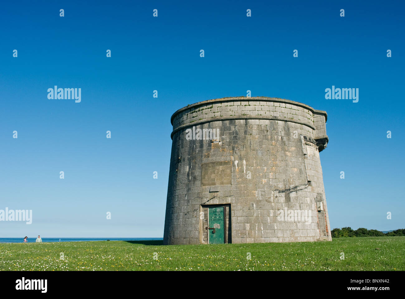 The Napoleonic era Martello defensive tower on Red Island at the seaside town of Skerries, north county Dublin, - Stock Image