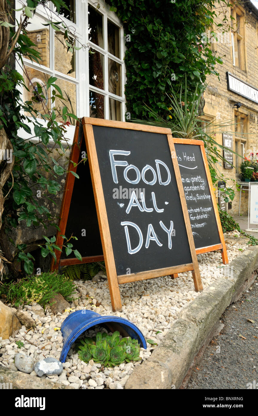 Food all day at The Queen's Head pub, Stow-on-the-Wold, Cotswolds, UK. - Stock Image