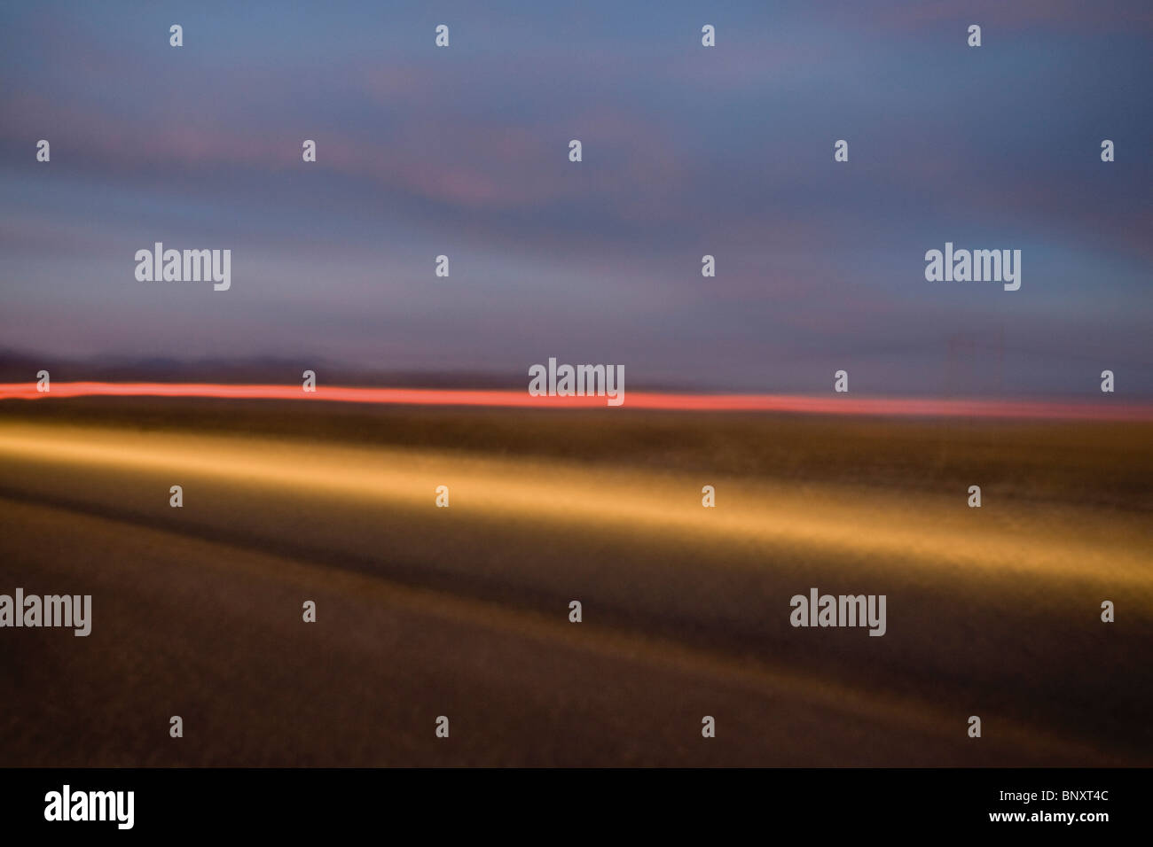 Light trails along highway - Stock Image