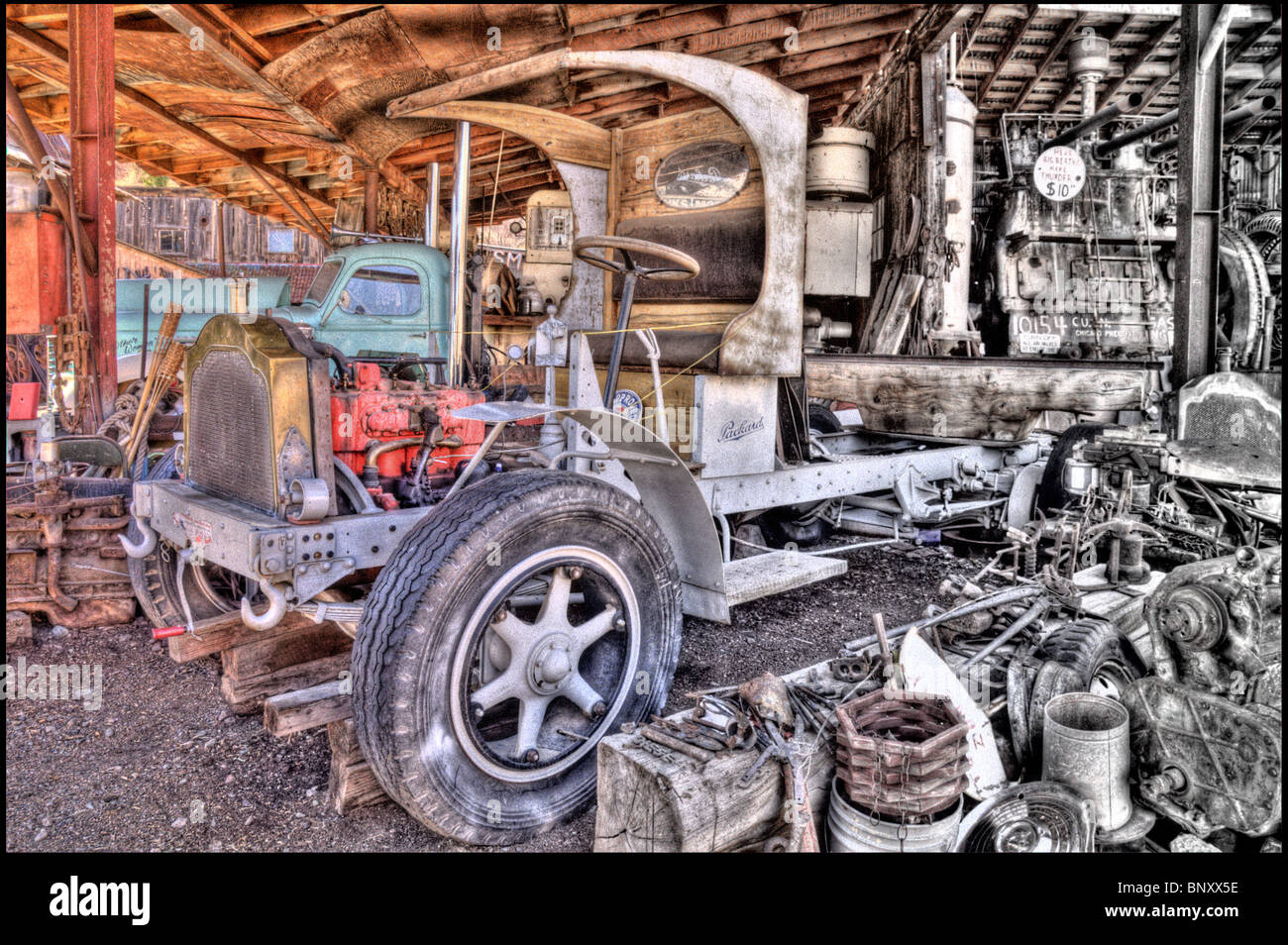 Old Truck in Auto Shop one half Colored and one half Black and White - Stock Image