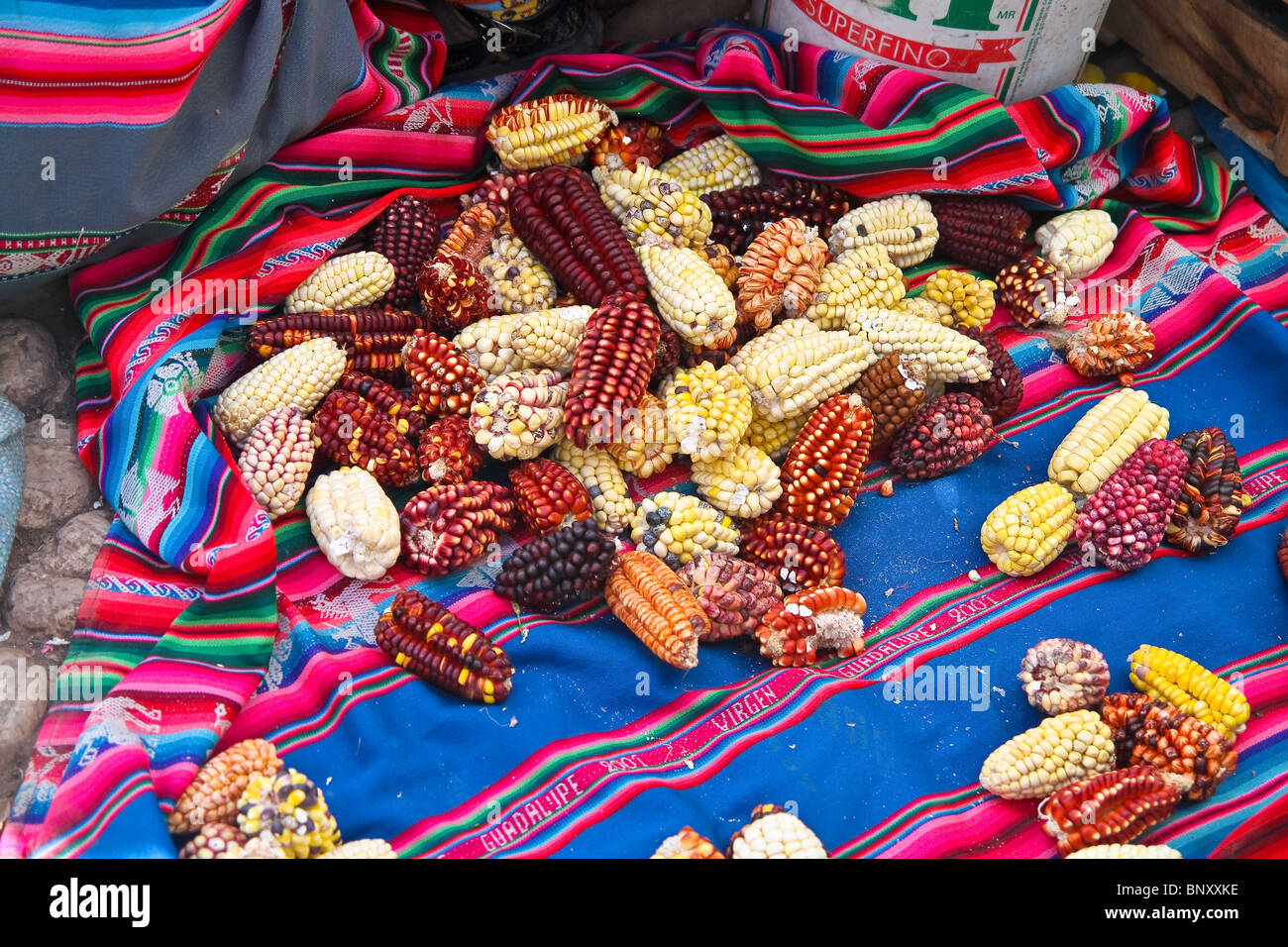 View of many different types of corn in the Pisac market, near Cusco, Peru. - Stock Image