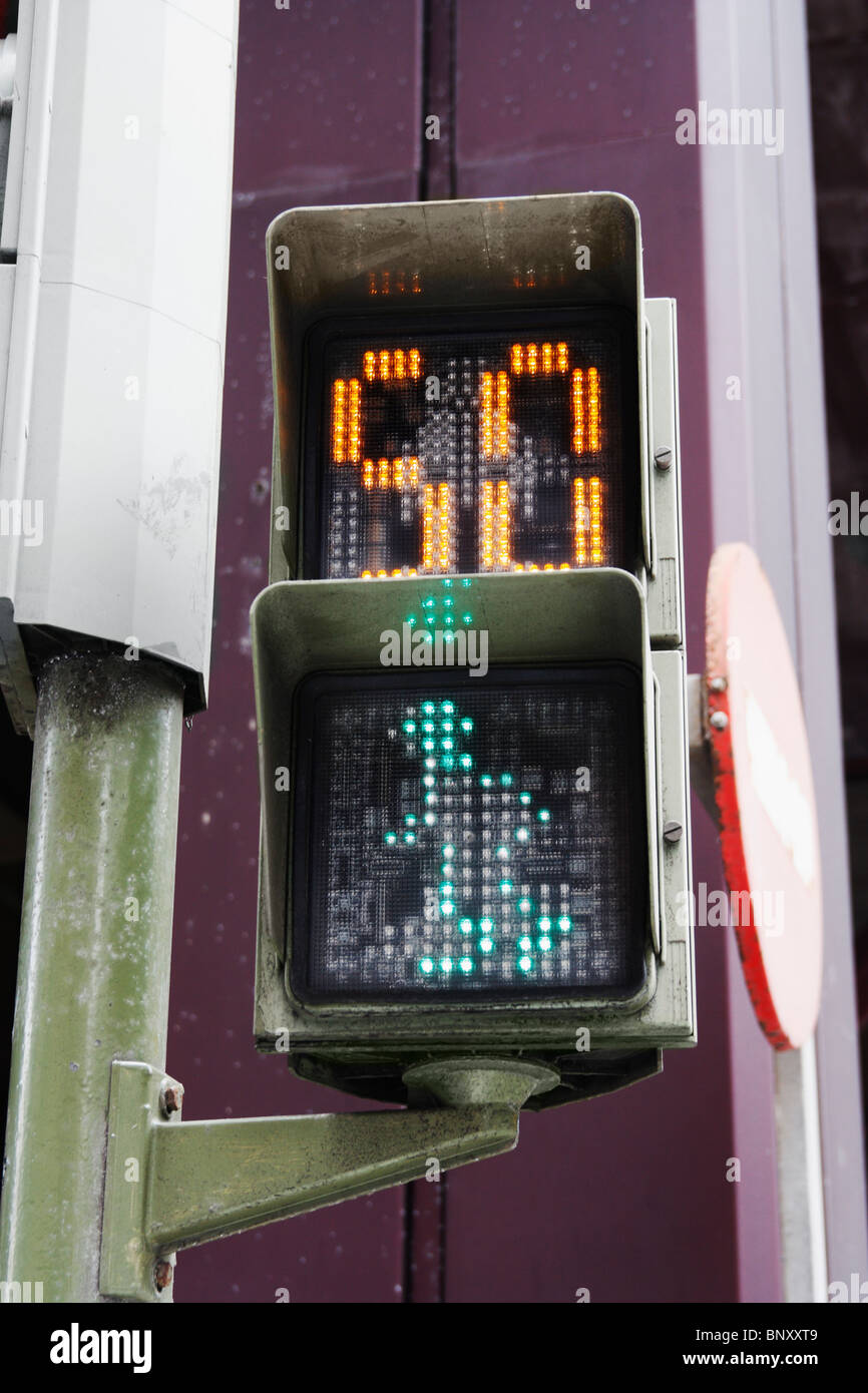 Pedestrian crossing in Spain with countdown timer. Image shows green man and 50 seconds - Stock Image