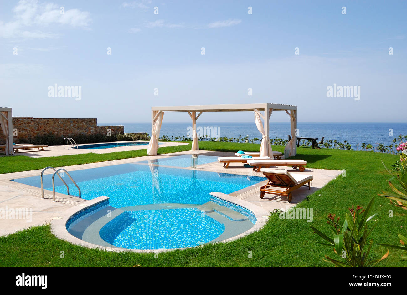 Swimming pool with jacuzzi at the beach of modern luxury villa Stock ...