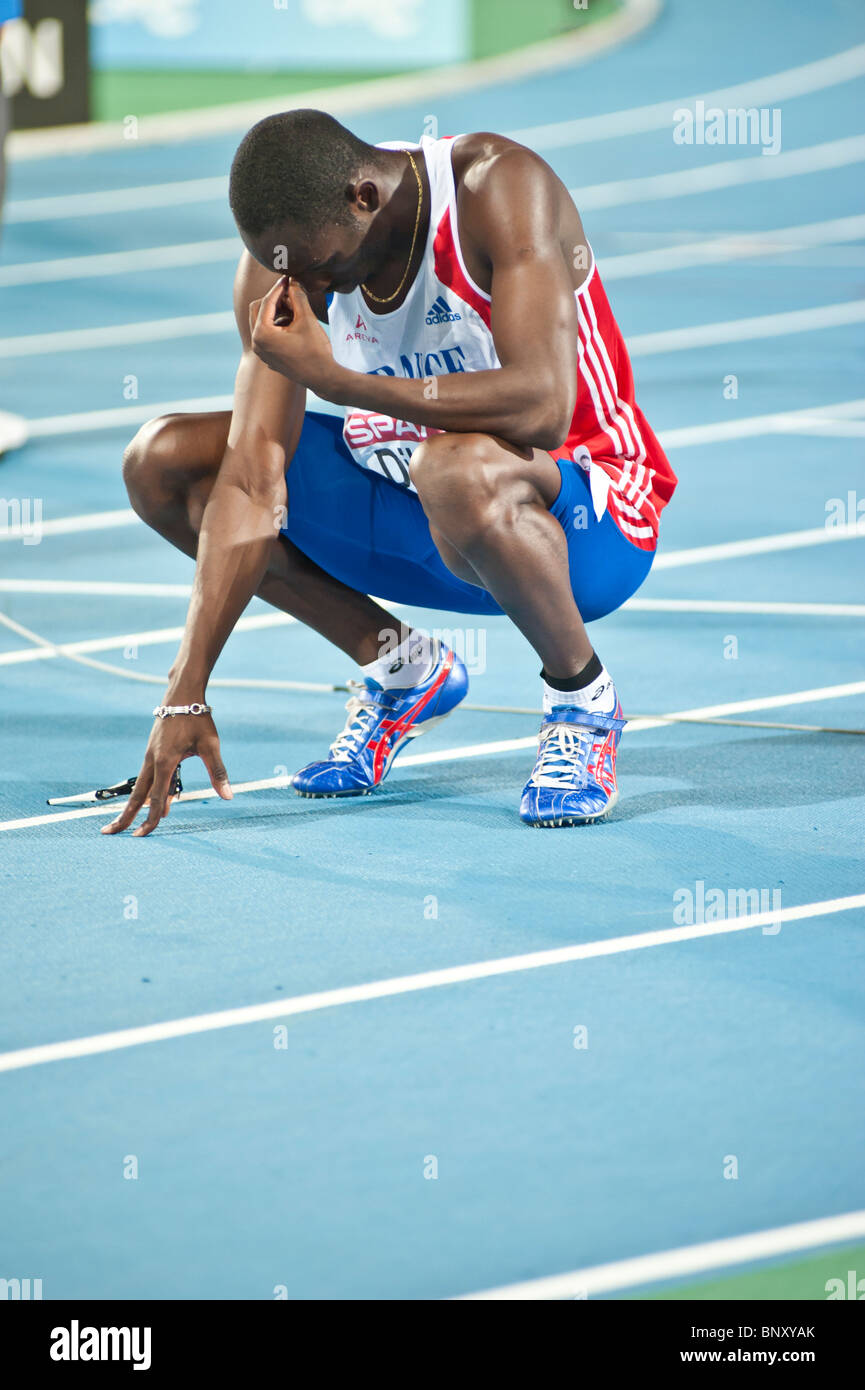 BARCELONA July 30th 2010: French Athlete Leslie Djhone in tears after being 6th in the 400m Final. - Stock Image