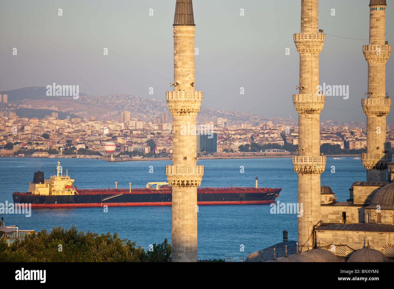 Tanker and Sultan Ahmed or the Blue Mosque in Istatnbul, Turkey - Stock Image