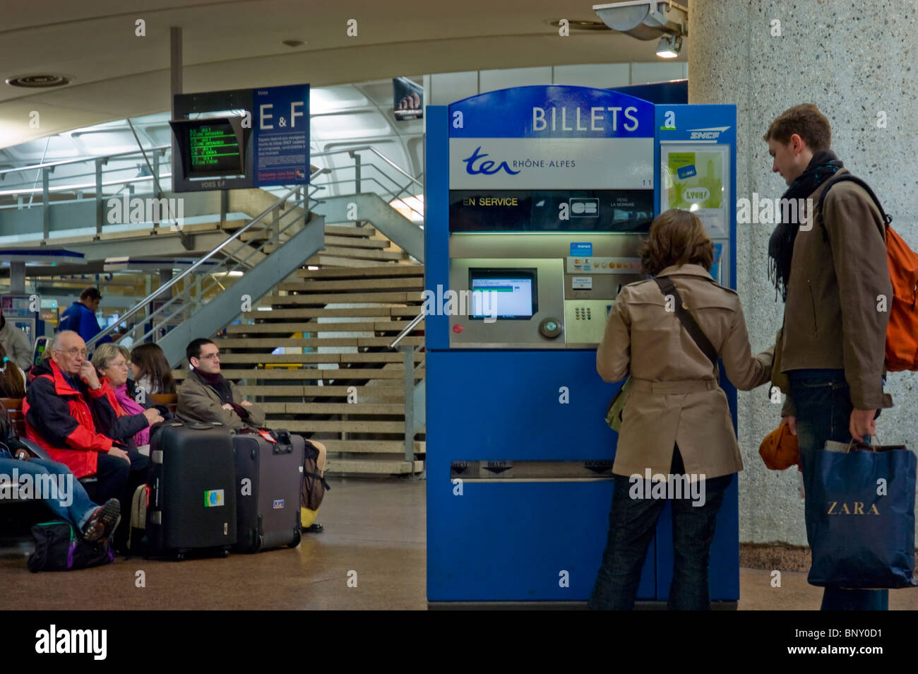 Lyon, France, Couple, inside  Train Station, Passengers Buying Tickets, from vending machine Stock Photo