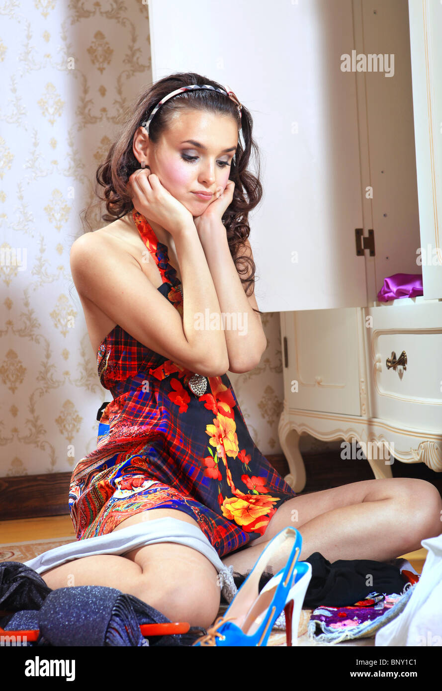 beautiful young woman don't know what to wear - Stock Image