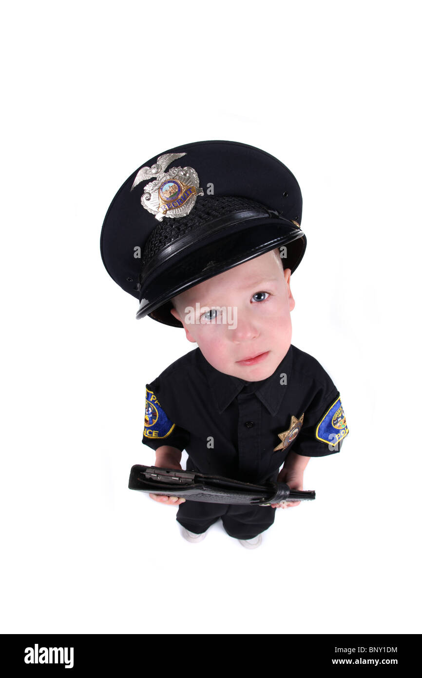 Little Boy Dressed up as a Police Officer Top View Fisheye - Stock Image
